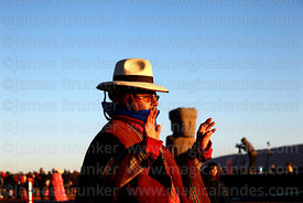An Aymara leader holds up his hands to receive the sun's energy at sunrise during Aymara New Year celebrations, Tiwanaku, Bol...