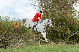Joss Hanbury jumping a hedge near Little Dalby. Quorn Hunt Opening Meet 2018