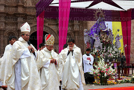 Bishop of Puno Jorge Carrion Pablisch (centre) praying during central mass, Virgen de la Candelaria festival, Puno, Peru