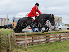 James Mossman jumping a hunt jump behind the kennels