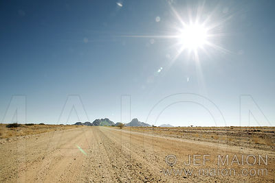 African dirt road under hot sun