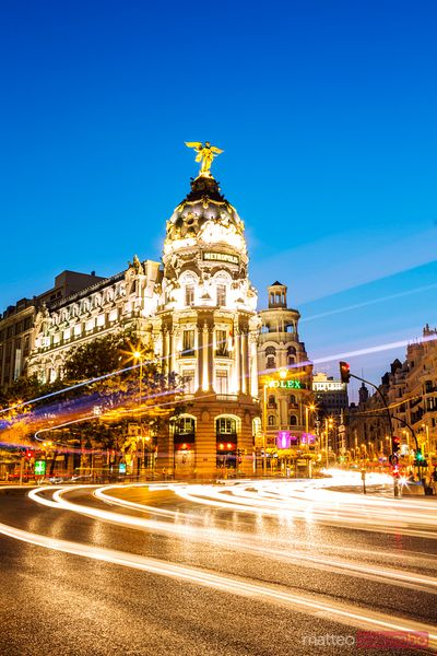 Cityscape at dusk with Metropolis building, Madrid, Spain