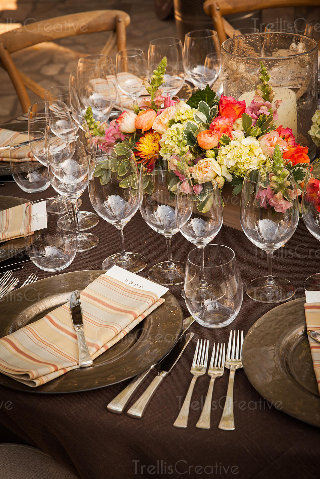 An elegant table setting with wine glasses and flowers