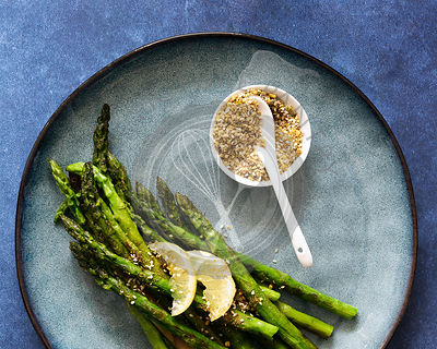 Chargrilled asparagus spears with lemon and pistachio dukkah.