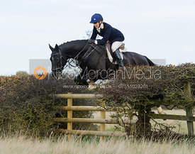 Katie Barber jumping a fence