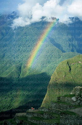 Rainbow over the Urubamba canyon, Putu Cusi mountain and tourist, Machu Picchu, Peru