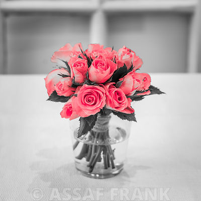 Bunch of roses in jar on table, Indoors