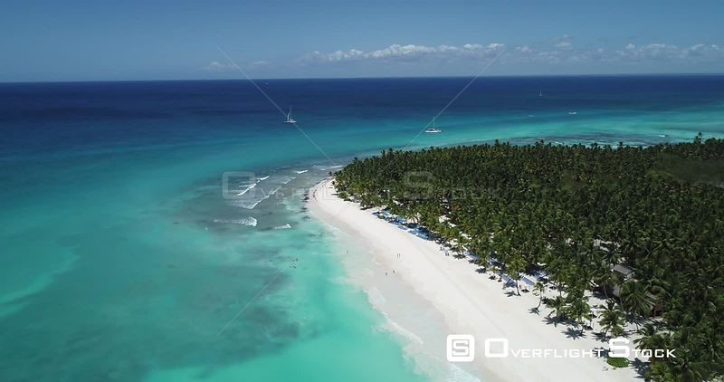 Caribbean beach and palm trees. High altitude flight going up . Saona Island, Dominican Republic
