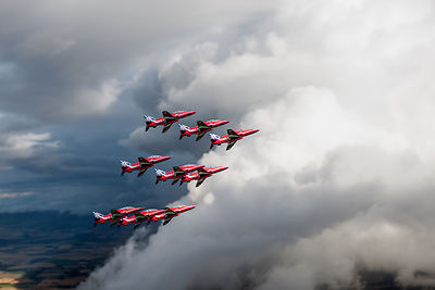 Cloud riding Red Arrows