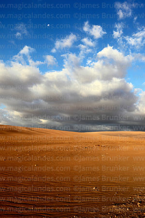Dramatic clouds and lighting over the Atacama Desert near Pica, Region I, Chile