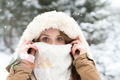 Portrait of smiling young woman in winter