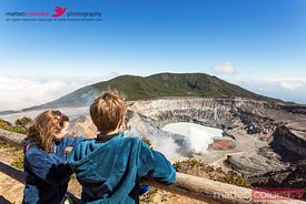Family looking in the crater of active volcano, volcan Poas, Costa RIca