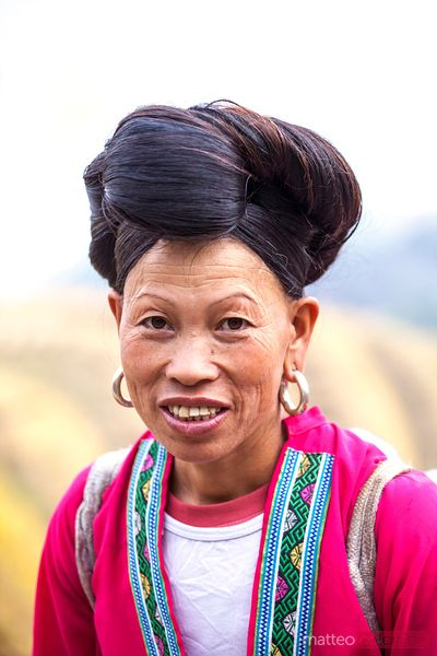 Yao ethnic minority woman on rice terrace, Guilin, China