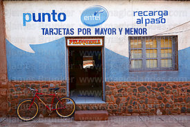 Bicycle outside Entel phone office and hairdressers, Camargo, Chuquisaca Department, Bolivia