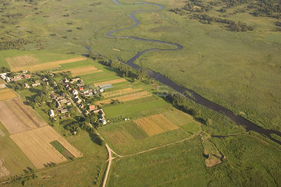 Aerial view of a village next to the Narev river, Poland.