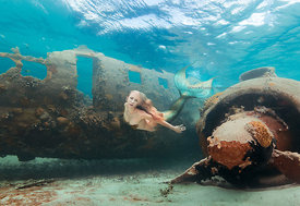 Mermaid Kristi Sherk underwater near sunken DC-3 drug plane, Exuma Cays, Bahamas Islands during Mermaid Portfolio Workshop