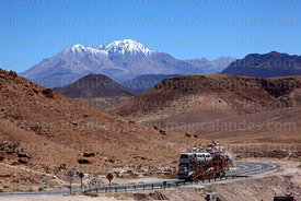Car transporter heading to Bolivia on Highway 11 from Arica , Region XV , Chile