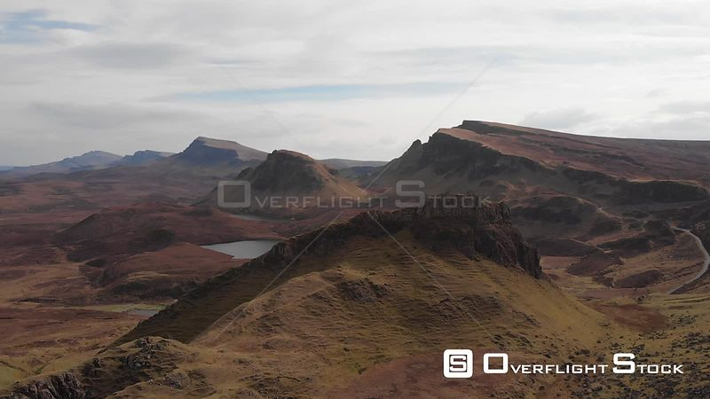 Aerial drone shot revealing a loch in Quiraing, Isle of Skye, Scotland