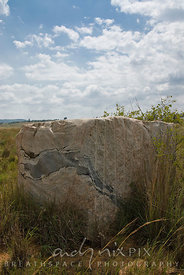 Vredefort Dome World Heritage Site, Freesate/Northwest Province, South Africa. A block of quaried rock composed of light and ...