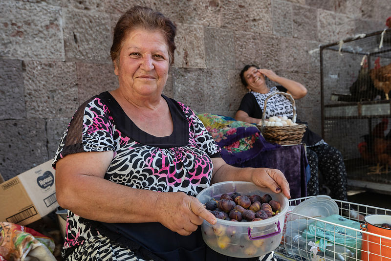 Woman Holding a Bowl of Figs at the Karayan Market