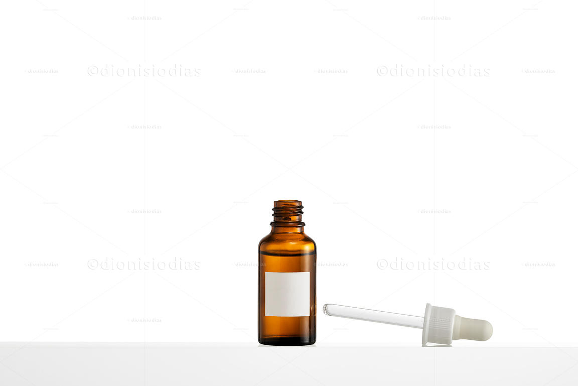 Medicine bottle with dropper on the side