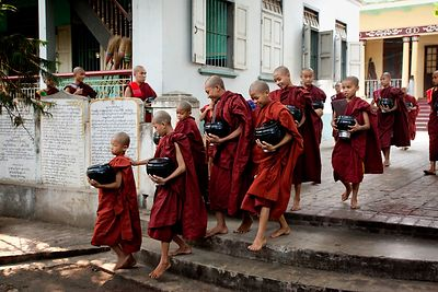 Young buddist monks in the largest monastery of Mandalay walk to the diningroom to have their only meal of the day, after col...