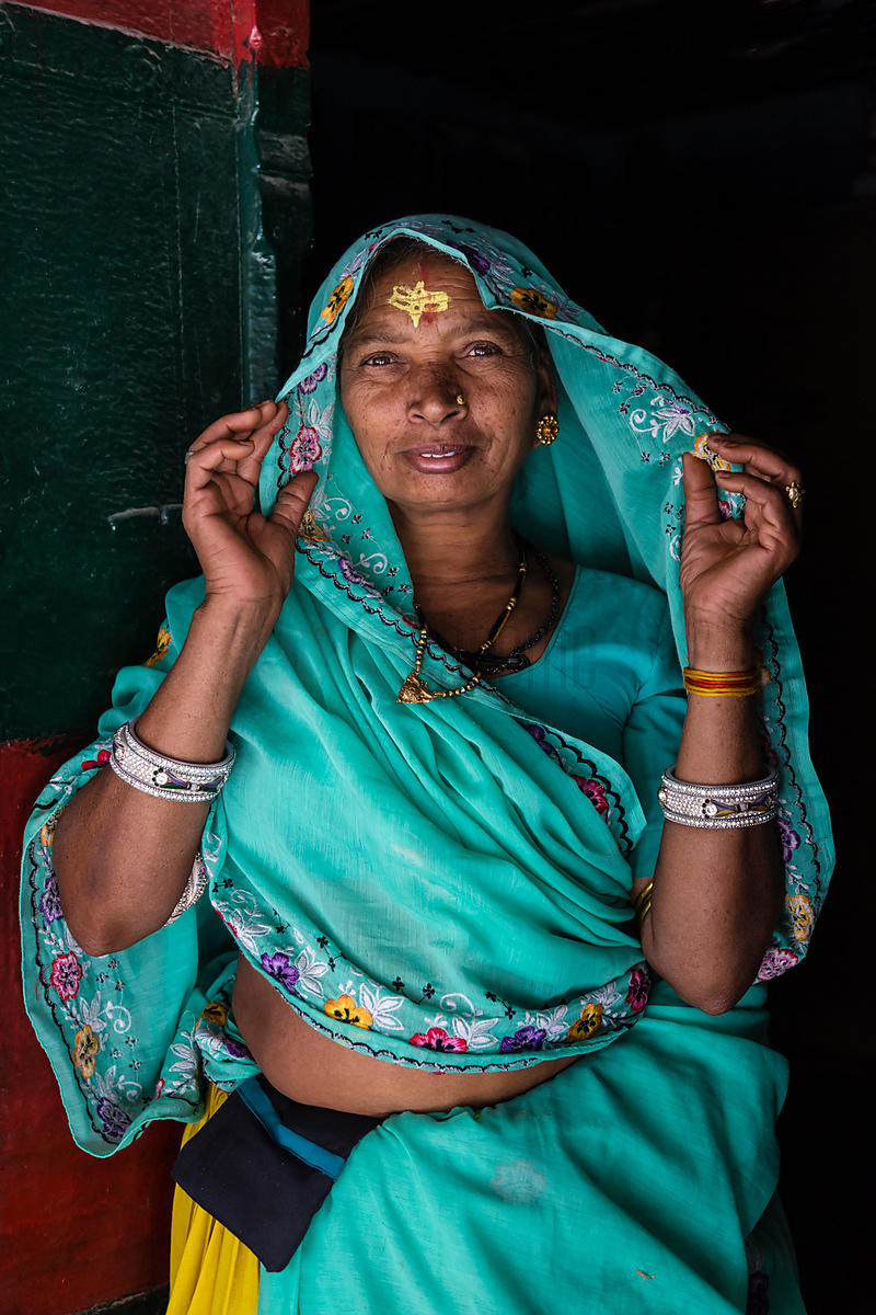 Portrait of a Woman in a Blue Sari Standing in the Doorway of her Home