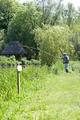 Fly fisherman casting line, River Test, Hampshire, England