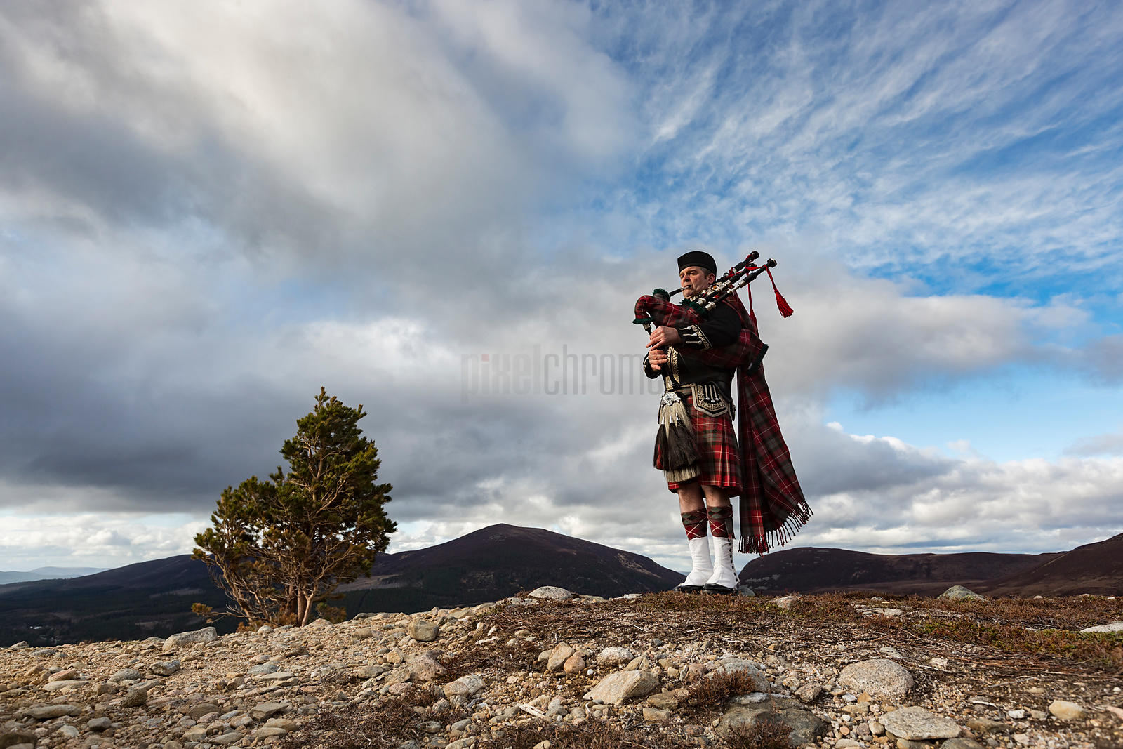 "Callum ""Spud"" the Piper Plays in the Cairngorm Mountains above Aviemore"
