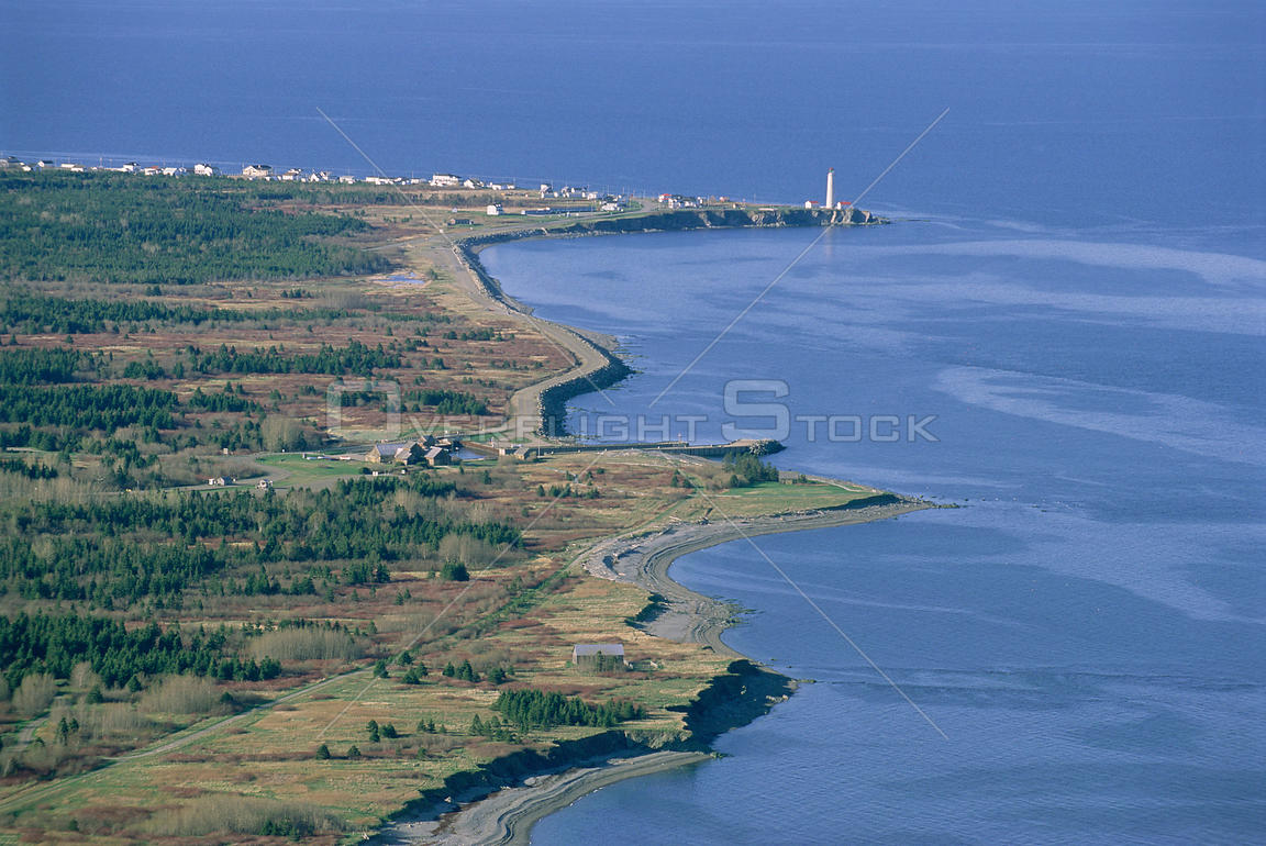 Coastline and lighthouse at Cap des Rosiers, Gaspesie, Quebec, Canada