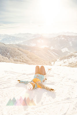 Austria, Salzburg State, Hochkoenig Region, female skier lying in snow