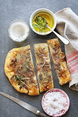 Focaccia bread with caramelized onions and rosemary.Top view