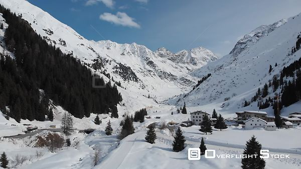 Aerial shot of Mittelberg village in Pitztal valley and Tyrolean Alps in Tyrol, Austria