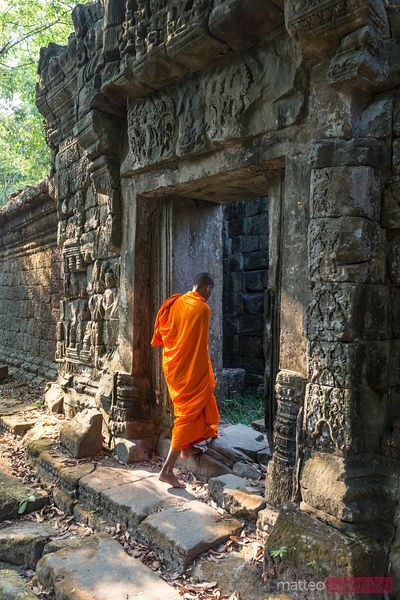 Monk walking in Angkor Wat complex, Cambodia
