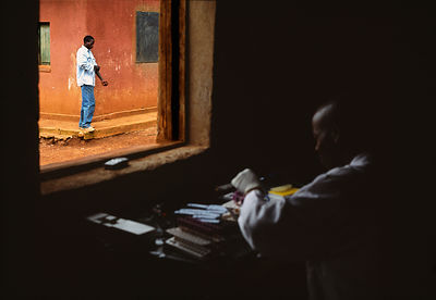 Rwanda - Kibileze - A patient walks past a window, having had an HIV test at Kibayi Health Centre