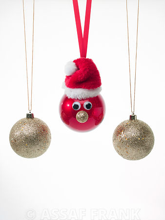 Christmas baubles hanging on white background