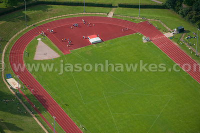 Aerial view over sports running and athletics track