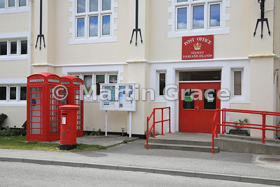 Stanley Post Office and Philatelic Bureau, housed in the Town Hall (1950), with British-style red telephone boxes and post bo...
