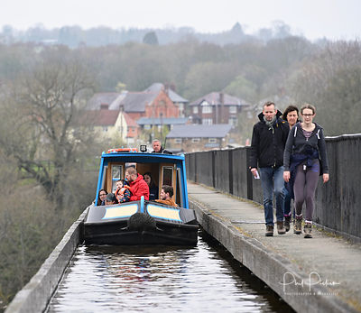 Walkers and boaters on the Pontcysyllte aqueduct.