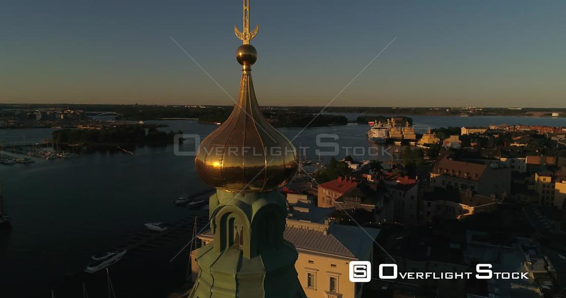Scandinavian City, Aerial View Around Uspetski Cathedral Golden Cupole, Revealing the City and Helsingin Tuomiokirkko, on a S...