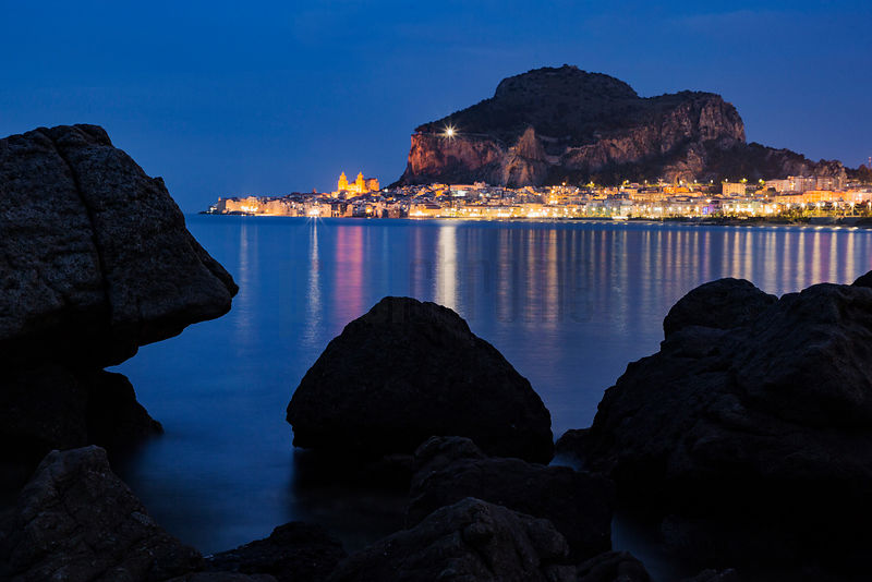 View of Cefalu Framed by Rocks at Dusk