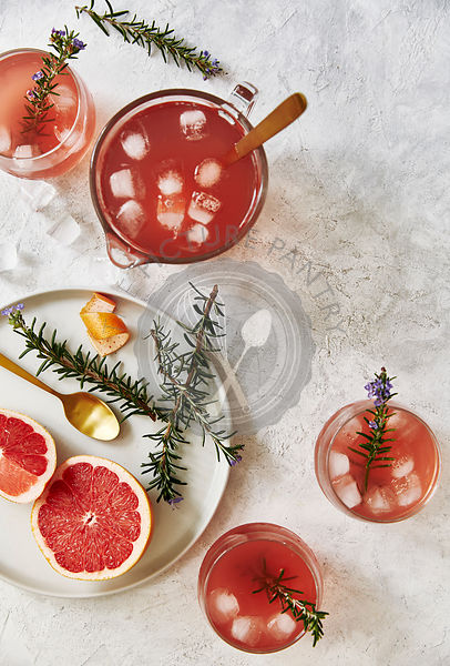 Freshly made grapefruit mocktail drink with rosemary.