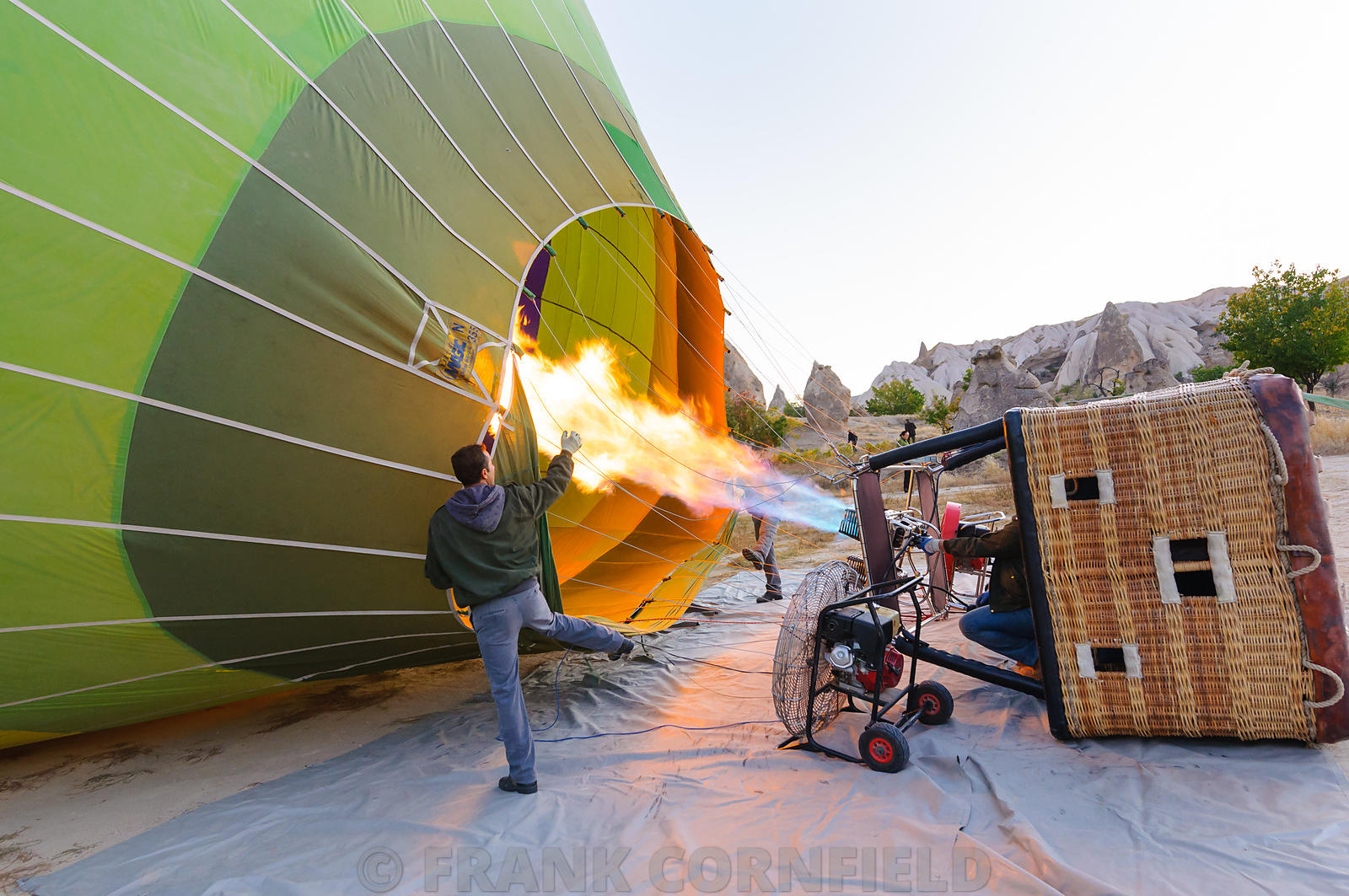 Hot air balloon being prepared for takeoff.