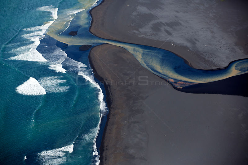 Aerial view of river and coastline, South West Iceland, June 2014.