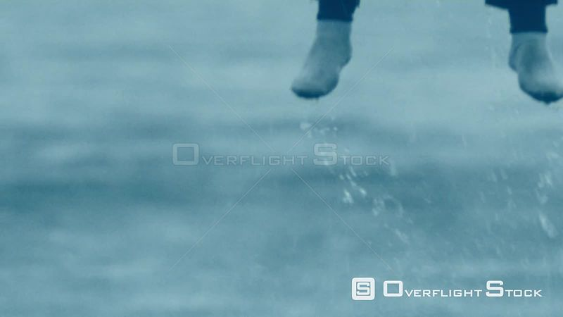 Aerial close up of a man being lifted out of the sea Cape Town Western Cape South Africa