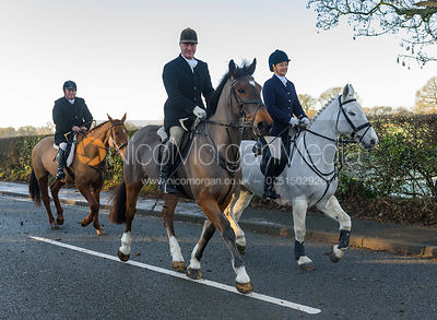 Peter Cooke, Joanne Rutter leaving the meet - The Cottesmore Hunt at Pickwell Manor 28/12