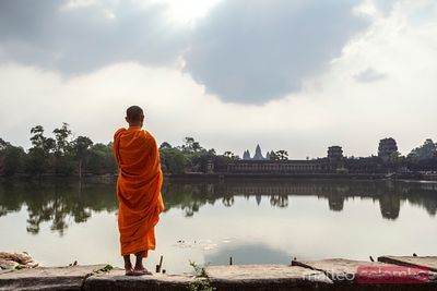 Cambodia, Angkor Wat. Monk in front of temple and river