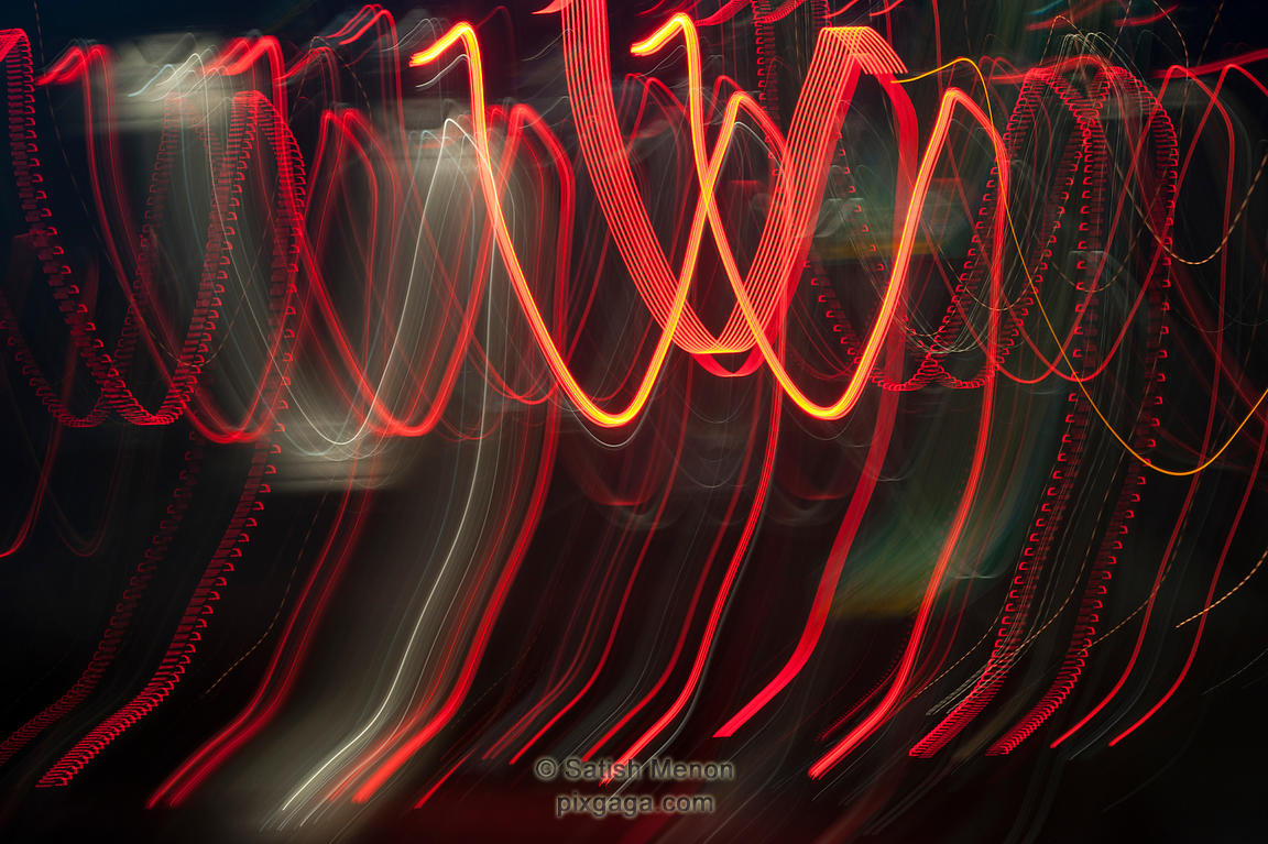 Traffic tail lights, shot with a moving camera