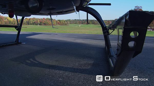 Fuselage-mount POV, helicopter taking off from airstrip