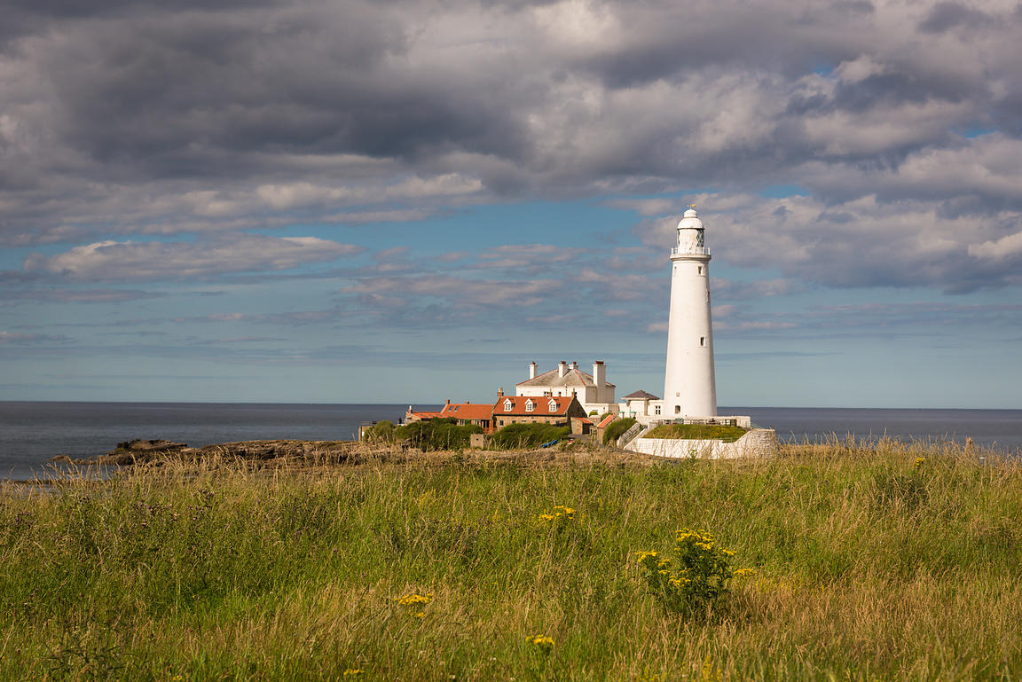 St Mary's Lighthouse near Whitley Bay in Tyne and Wear in the North East of England, and the adjacent keepers' residences, we...